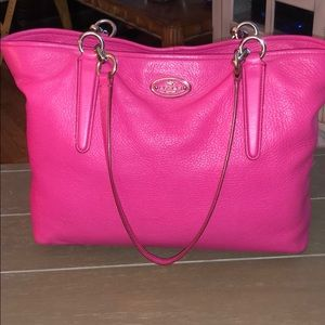 Coach leather hot pink hand bag with pink straps.